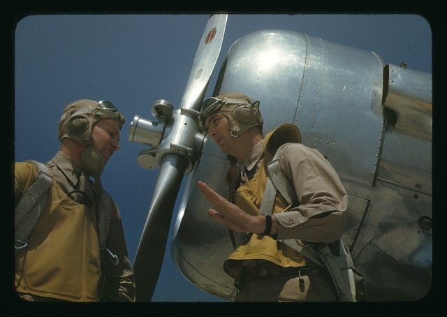 Marine lieutenants, pilots, by the power tow-plane for the training gliders at Page Field, Parris Island, S.C.