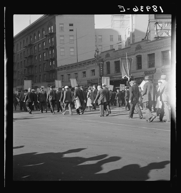 Mass meeting of Works Progress Administration (WPA) workers parading up Market Street, San Francisco, California. The meeting was held in protest to cuts made by Congress in relief appropriations
