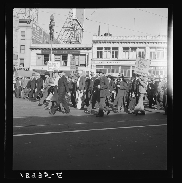 Mass meeting of Works Progress Administration (WPA) workers parading up Market Street. San Francisco, California. The meeting was held in protest to cuts make by Congress in relief appropriations