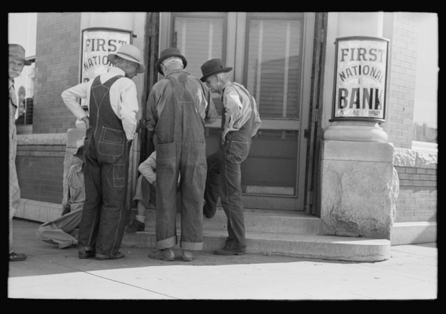 Men in front of bank, Frederick, Oklahoma