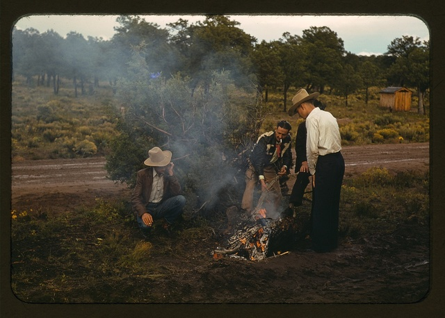 Men in front of outdoor fire, Pie Town Fair, New Mexico