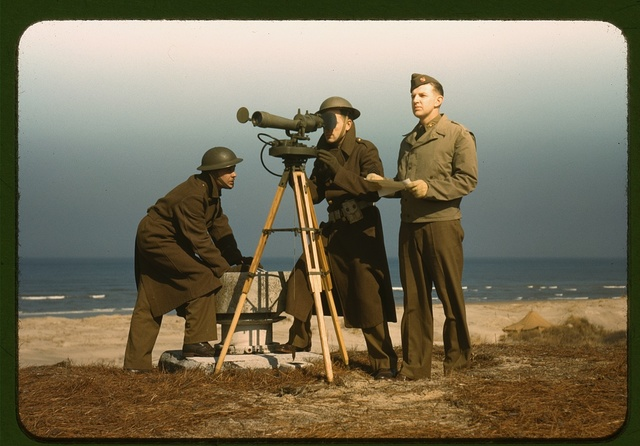 Men of Fort Story operate an azimuth instrument, to measure the angle of splash in sea-target practice, Fort Story, Va.