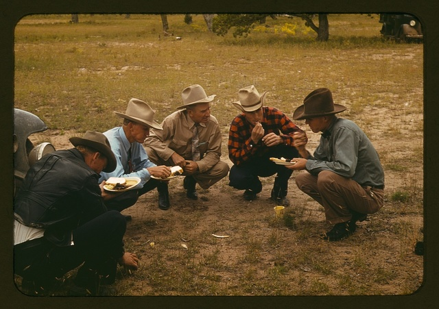 Men of the community of Pie Town, New Mexico eating at the barbeque