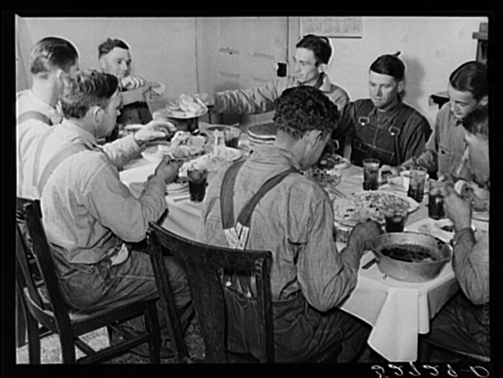 Men of the Wilkins clan eating dinner on cornshucking day at home of Mrs. Fred Wilkins. Tallyho, near Stem, Granville County, North Carolina