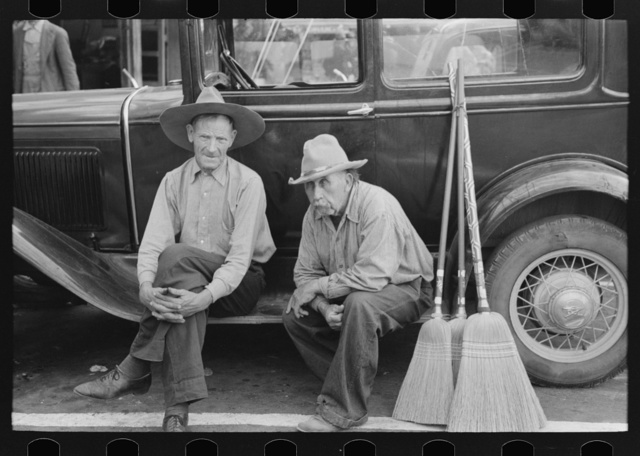 Men sitting on side of car, market square, Waco, Texas
