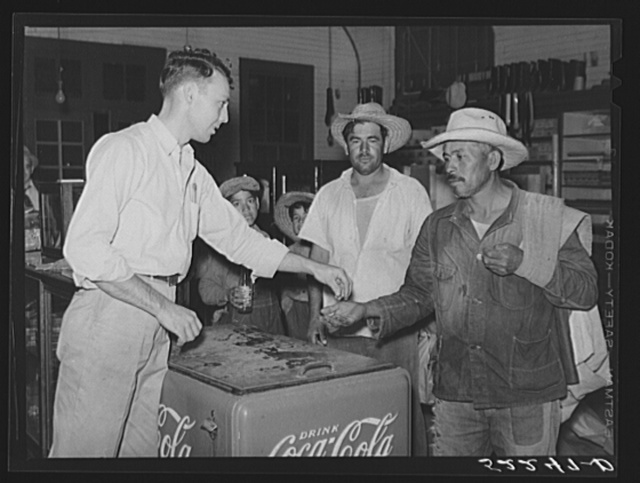Mexican cotton pickers inside plantation store. Knowlton Plantation, Perthshire, Mississippi Delta. This transient labor is contracted for and brought in trucks from Texas each season. Mississippi Delta, Mississippi