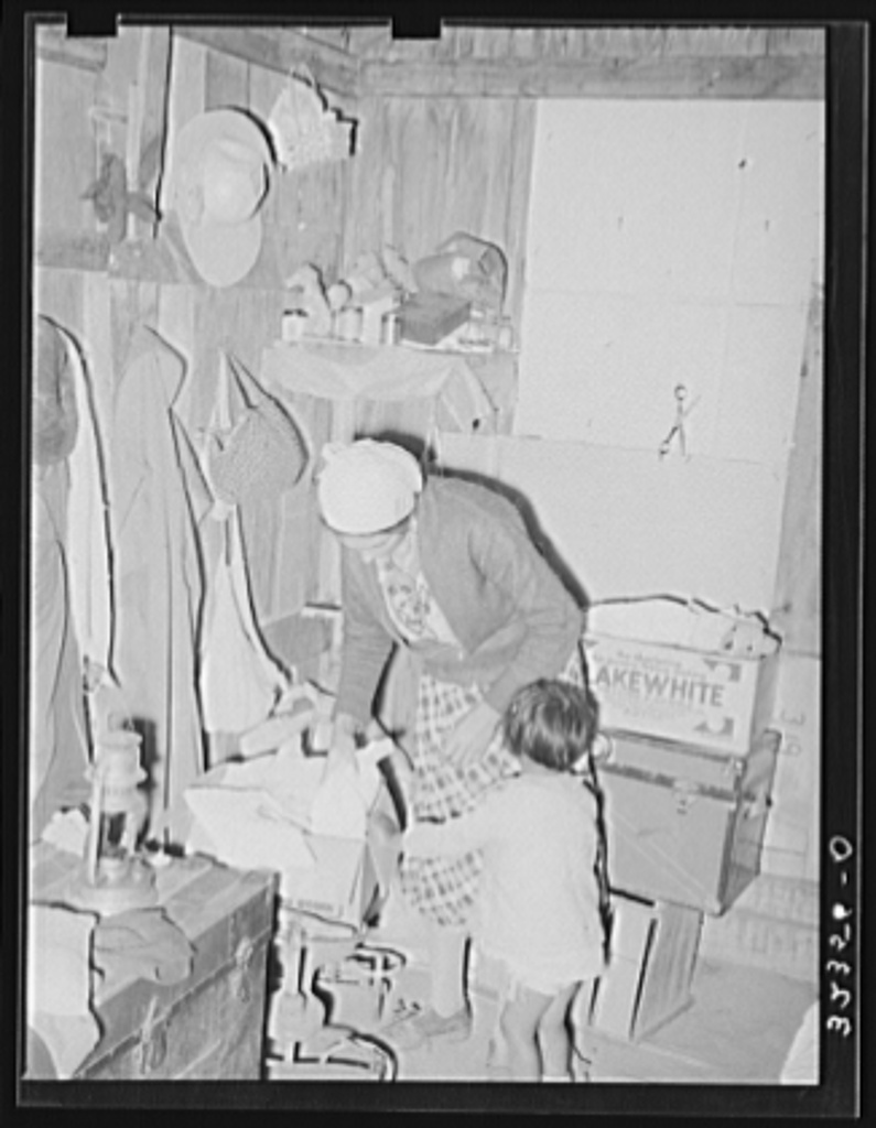 Mexican mother in crowded home. Notice the covered windows. Crystal City, Texas
