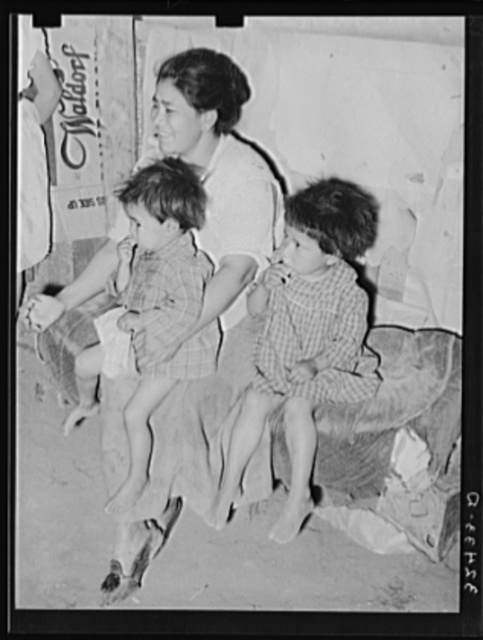 Mexican mother with her children in their home in the outskirts of San Antonio, Texas