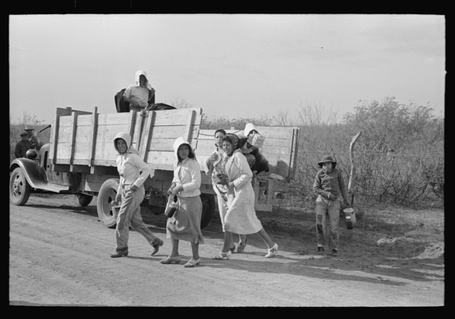 Mexican women leaving truck which brought them to the spinach field, La Pryor, Texas