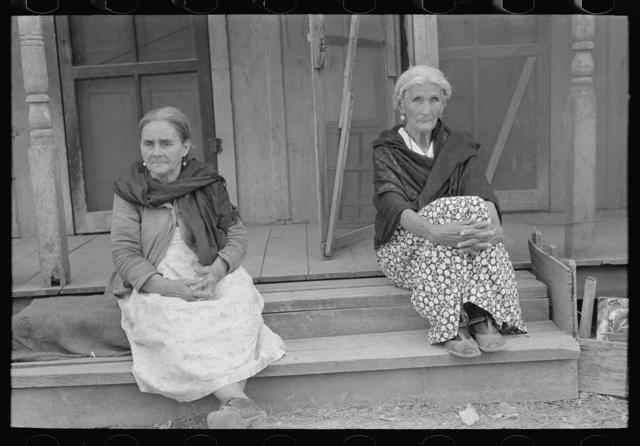 Mexican women sitting on porch, San Antonio, Texas