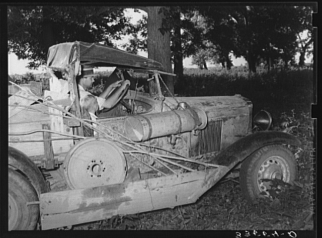 Migrant agricultural worker from Texas in his automobile in Wagoner County, near Tullahassee, Oklahoma