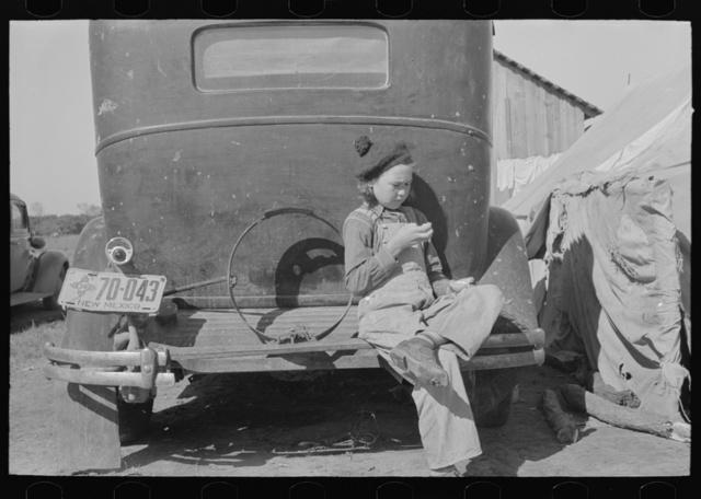 Migrant girl sitting in back of car, Weslaco, Texas