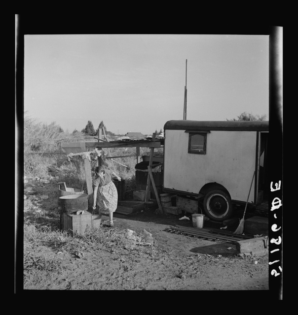 Migrant laborers camped beside a packinghouse in Belle Glade, Florida