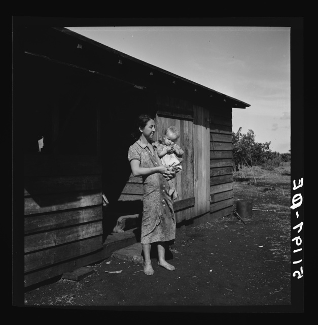 Migrant laborer's wife and child. She is thirty-two years old has had eleven children. See 51187-E. Belle Glade, Florida