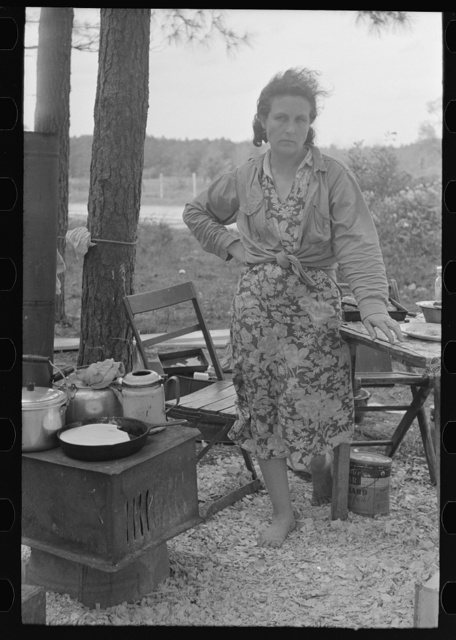 Migrant mother in front of outdoor stove near Hammond, Louisiana strawberry center