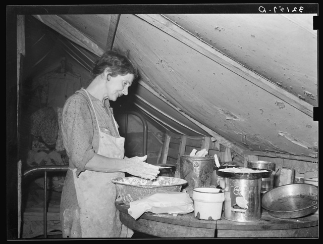 Migrant mother making biscuits in tent home near Mercedes, Texas. See 32108-D