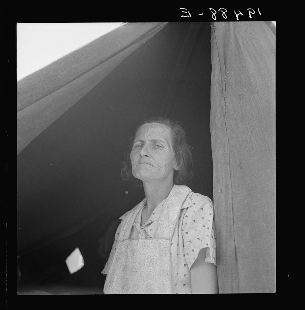 Migrant woman from Arkansas living in contractor's camp near Westley, California. She would prefer to live in a government camp, but the contractor system prevents, because of control over allocations of work