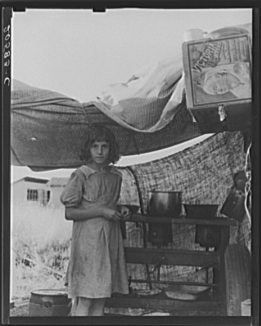 Migratory child at end of day in bean pickers' camp near West Stayton, Oregon. See general caption number 46