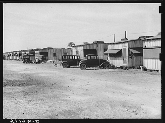 Migratory laborers' camp. Single-room cabin costs two dollars and fifty cents, double room four dollars per week. Water hauled, usually priced at fifty-five cents for fifty-five gallon tank. Toilet for about 150 people. Near Belle Glade, Florida