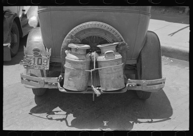 Milk cans tied on back of farm automobile, Muskogee, Oklahoma