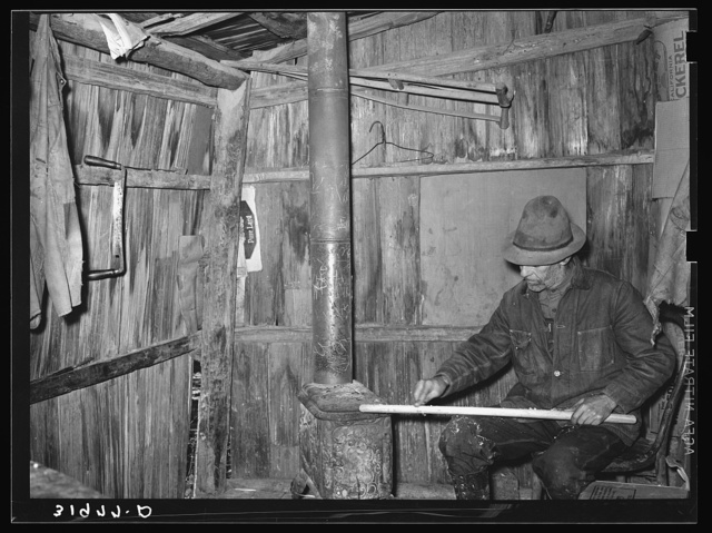 Mot Tucker making ax handles in living room of his corncrib home. Antioch, Mississippi
