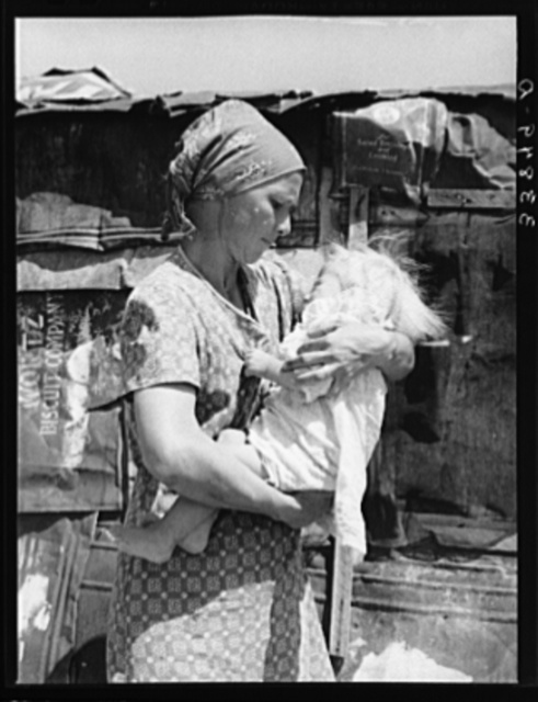 Mother and child in front of shack in Mays Avenue camp. Oklahoma City, Oklahoma. Refer to general caption no. 21