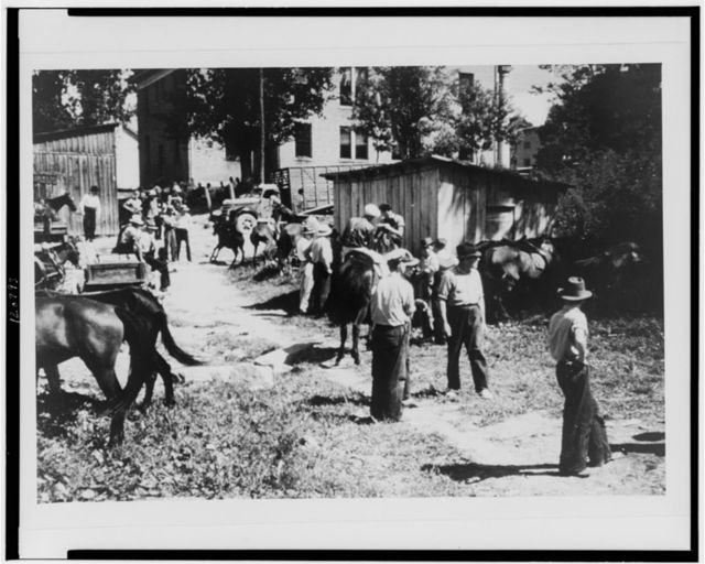 "Mountaineers and farmers trading mules and horses on ""Jockey St.,"" near the Court House, Campton, Wolfe County, Ky."