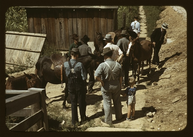 "Mountaineers and farmers trading mules and horses on ""Jockey St.,"" near the Court House, [Campton], Wolfe County, Ky."