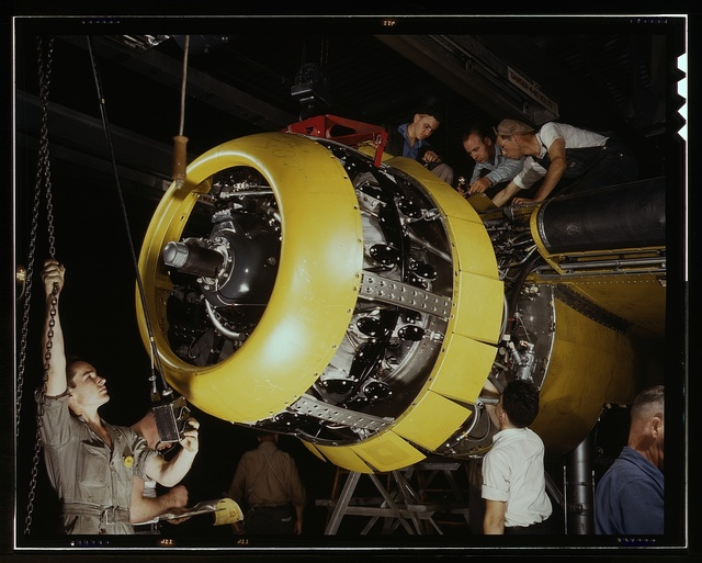 Mounting motor [on a] Fairfax B-25 bomber, at North American Aviation, Inc., plant in [Inglewood], Calif.