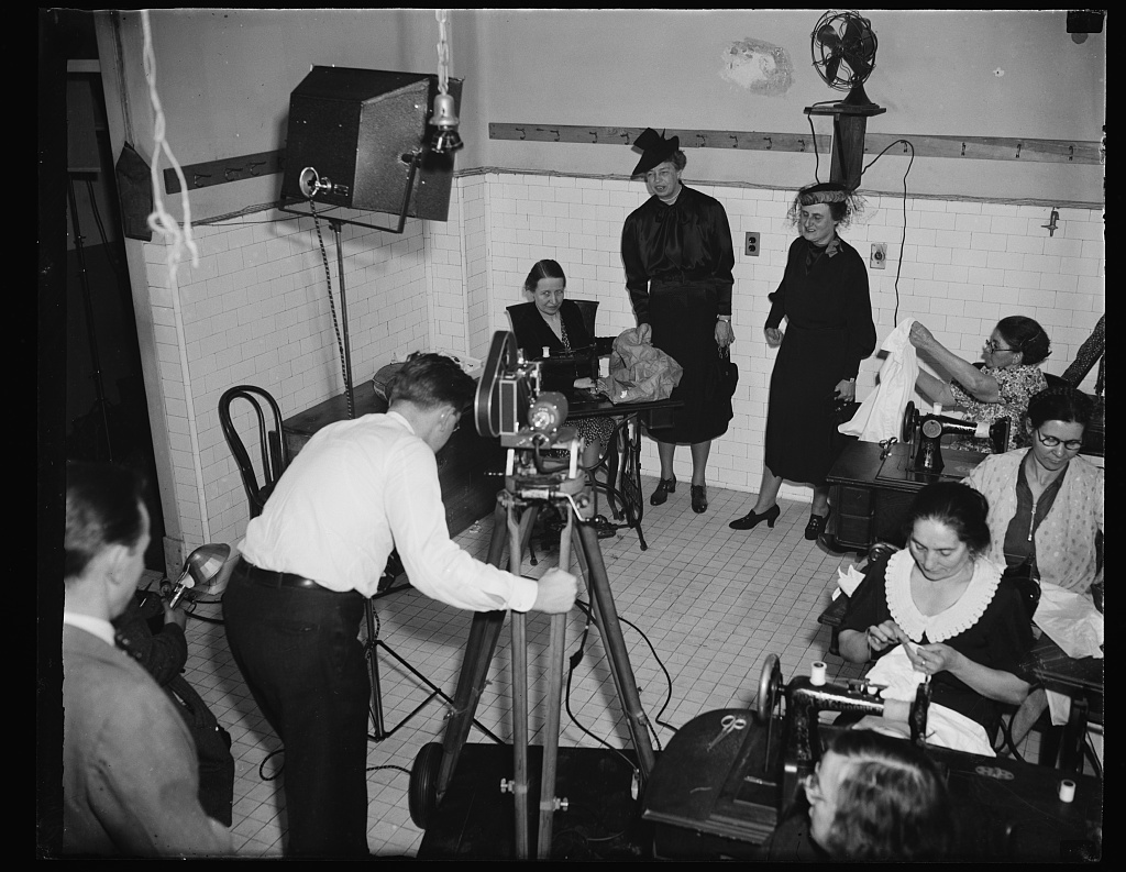 MOVIES RECORD VISIT OF FIRST LADY AND WIFE OF TREASURY SECRETARY TO SELF HELP EXCHANGE. WASHINGTON, D.C., FEBRUARY 9. WHEN MRS. FRANKLIN D. ROOSEVELT AND MRS. HENRY MORGANTHAU TODAY VISITED THE SELF-HELP EXCHANGE HERE, MOVIE NEWS CAMERAS WERE ON HAND . FACING THE MOVIE PHOTOGRAPHER ARE MRS. MORGANTHAU AND MRS. ROOSEVELT. THEY CAME TO THE EXCHANGE TO SEE THE UNEMPLOYED EMPLOYABLES PRODUCE GOOD, BE PAID IN SCRIP AND BUY COMMUNAL ARTICLES FOR THEIR OWN USE