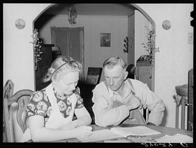 Mr. and Mrs. Fred Maschman going over their record book discuss ways of making their new farm, purchased with FSA (Farm Security Administration) aid, more profitable. Iowa County, Iowa