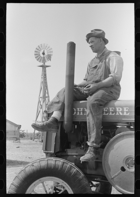 Mr. Germeroth, Farm Security Administration client sitting on tractor which was bought by means of FSA loan, Sheridan County, Kansas