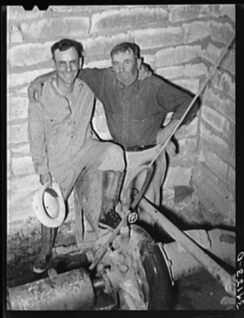 Mr. Johnson and Mr. Wright, owners and cooperators in irrigation well on farm near Syracuse, Kansas. They are FSA (Farm Security Administration) clients