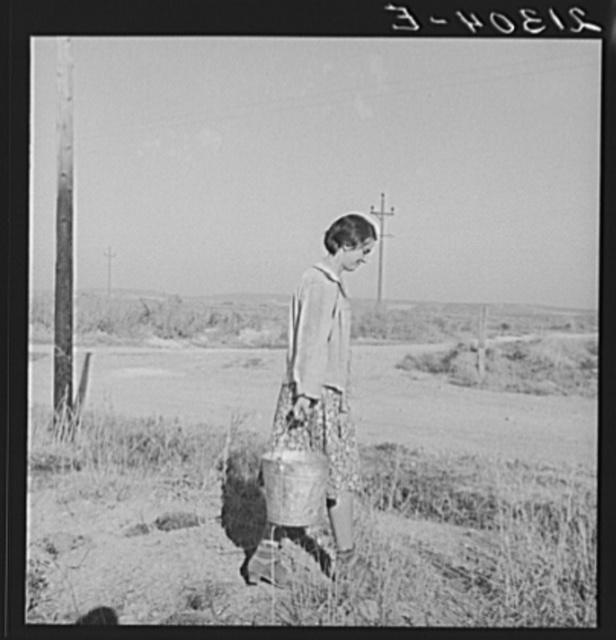 Mrs. Bartheloma hauls water from irrigation ditch. Nyssa Heights, Malheur County, Oregon