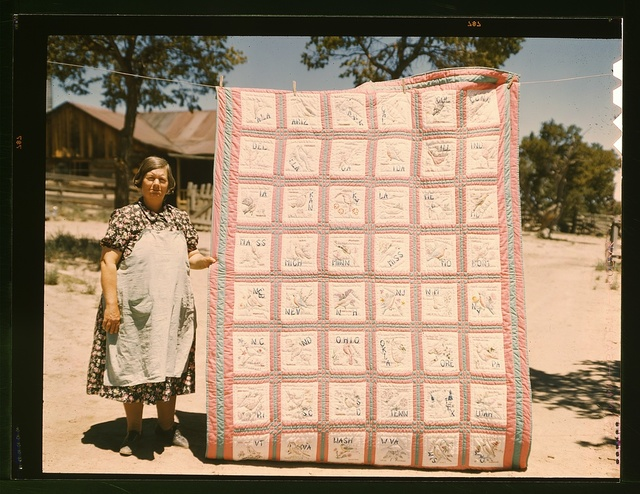 Mrs. Bill Stagg with state quilt that she made, Pie Town, New Mexico. A community settled by about 200 migrant Texas and Oklahoma farmers who filed homestead claims ... Mrs. Stagg helps her husband in the field with plowing planting, weeding corn and harvesting beans. She quilts while she rests during the noon hour.
