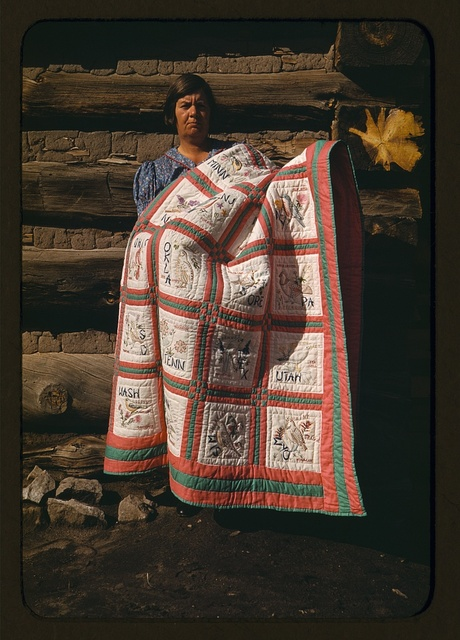 Mrs. Bill Stagg with state quilt which she made, Pie Town, New Mexico