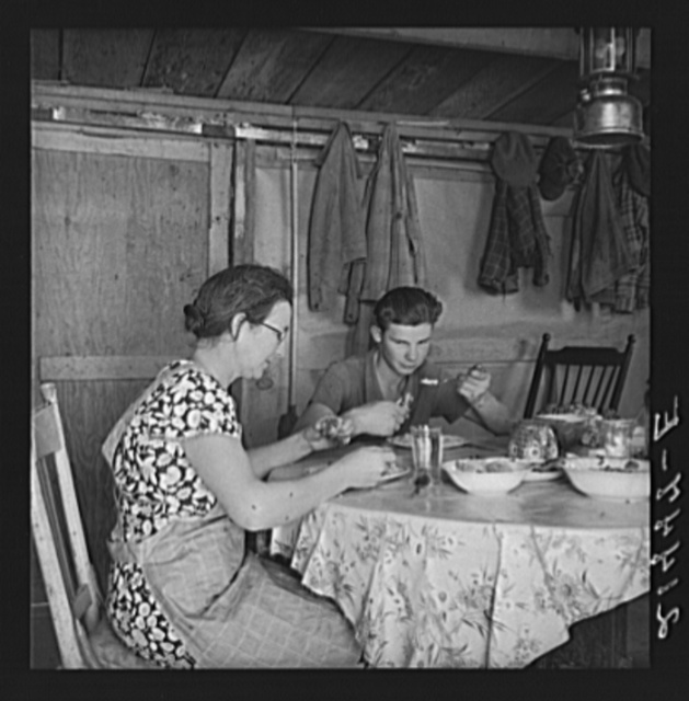 Mrs. Dazey and sixteen year old at lunch. The other children are working in neighbor's fields topping onions. Homedale district, Malheur County, Oregon