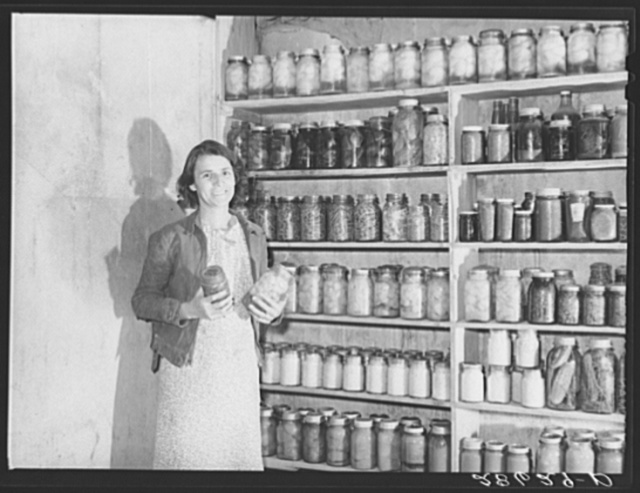 Mrs. H.H. Poland, wife of FSA (Farm Security Administration) rehabilitation client, with preserved food. Mesa County, Colorado