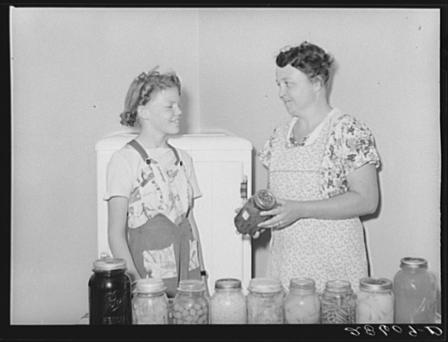 Mrs. Thomas Beede and daughter Margaret with preserved food. Western Slope Farms, Colorado