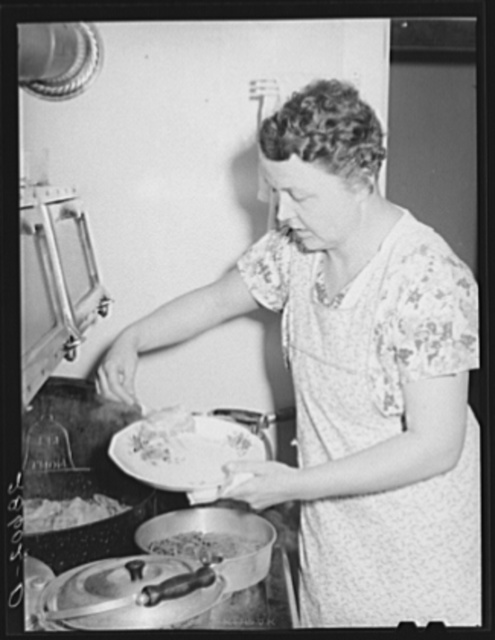 Mrs. Thomas Beede serving dinner resettlement home. Western Slope Farms, Colorado