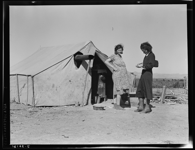 Near Calipatria, Imperial Valley, California. In grower's camp for migrant labor on the edge of the pea fields. Public health nurse interviews and advises prospective mother, aged seventeen, before arrival of first baby. Husband, aged twenty-three, is out picking. Made seventy-three cents this morning