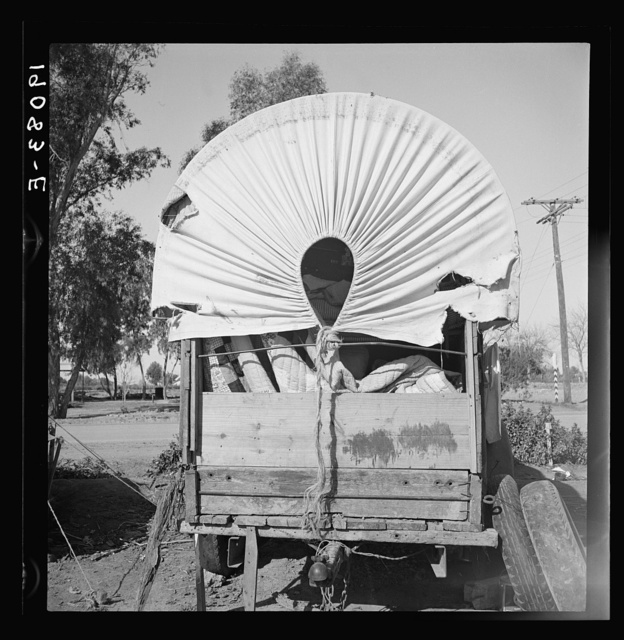 Near Holtville, Imperial Valley. Again the covered wagon. In migratory carrot puller's camp