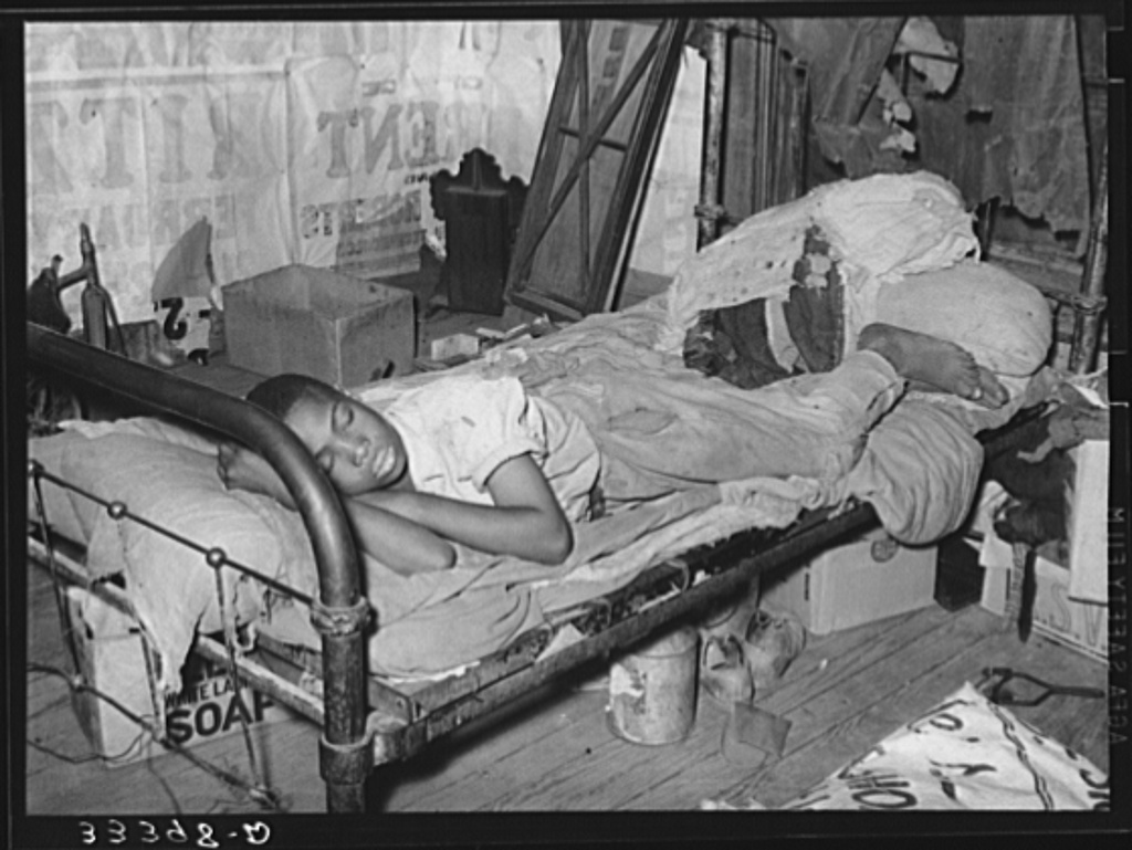 Negro agricultural day laborer taking a nap in his home. Muskogee, Oklahoma. Muskogee County