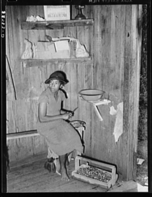 Negro woman strawberry worker cutting up berries to make wine. Hammond, Louisiana