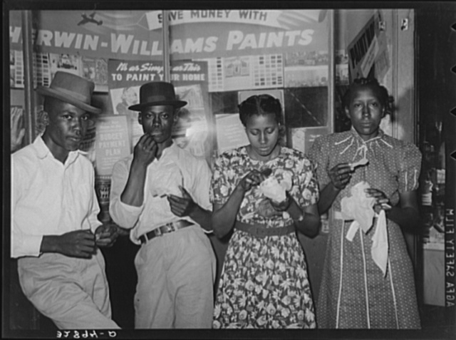 Negroes eating ice cream in front of hardware store. San Augustine, Texas