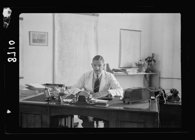 New broadcasting studios on Queen Milisande's Way, Jerusalem. W.K. Brasher, Esq. At his desk. Chief Engineer, leaving Jerusalem