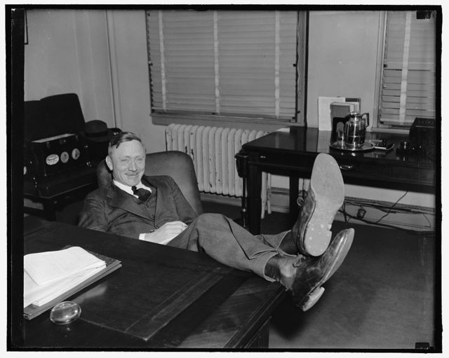 New Supreme Court Nominee. Washington, D.C., March 20. William O. Douglas, at 40 youngest man ever to be appointed to the Supreme Court, was all smiles and perfectly relaxed as cameramen called on him following the announcement by president Roosevelt today. Lounging back with feet on desk this picture of Douglas is familiar to all newsmen attending his frequent press conferences, 3-20-39