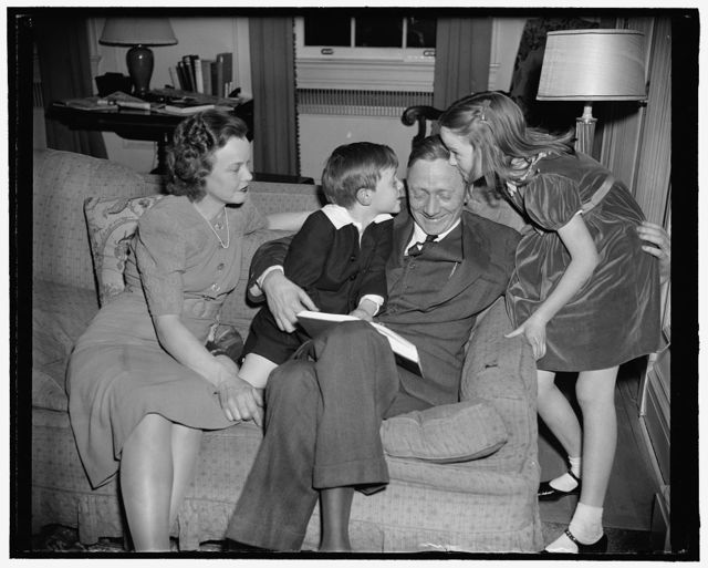 Newest Supreme Court appointee and family. Washington, D.C., March 20. Mrs. William Douglas, William, Jr., William Sr., and daughter Mildred Riddle at home tonight as they posed for photographs, following a day of excitement at the SEC when the President announced Mr. Douglas as his newest appointee to the Supreme Court to succeed Justice Brandeis, resigned. 3-20-39