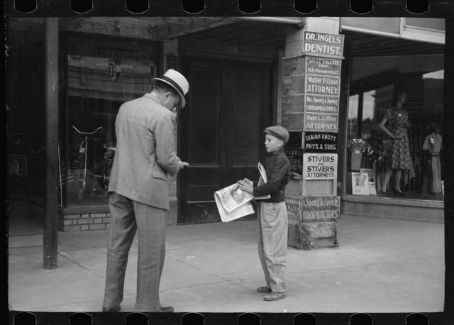 Newsboy on main street, Montrose, Colorado