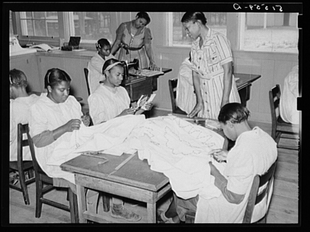 NYA (National Youth Administration) girls making bedspreads under supervision of Juanita Coleman, NYA leader, in school home economics room. Gee's Bend, Alabama